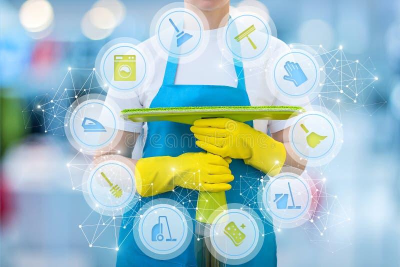 La donna delle pulizie con pulizia assiste le icone immagine stock
