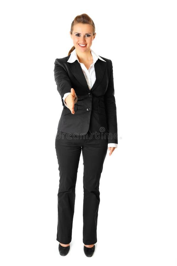 La donna di affari allunga fuori la mano per la stretta di mano immagini stock libere da diritti