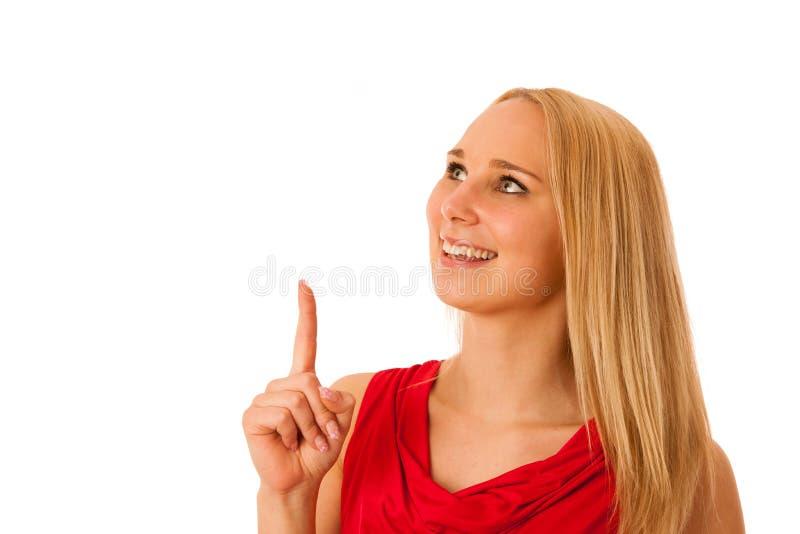 La donna di affari in camicia rossa che indica nello spazio della copia ha isolato la o fotografie stock