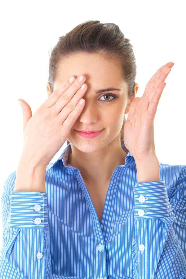 La donna di affari copre uno dei suoi occhi, isolato fotografie stock libere da diritti