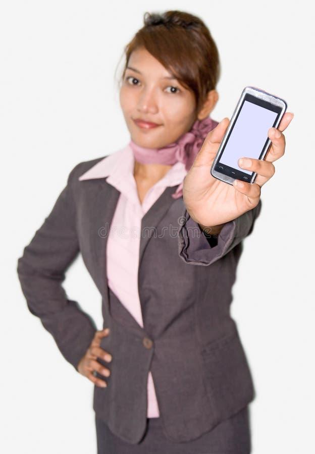 La donna di affari mostra il suo mobile fotografia stock