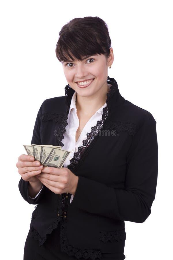 La donna di affari salva in su i certi soldi e sorridere. fotografie stock