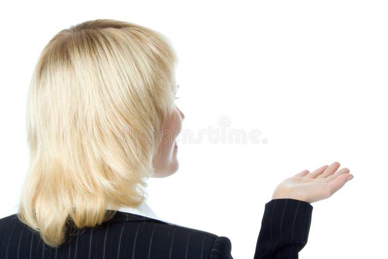 La donna di affari si leva in piedi indietro fotografia stock libera da diritti
