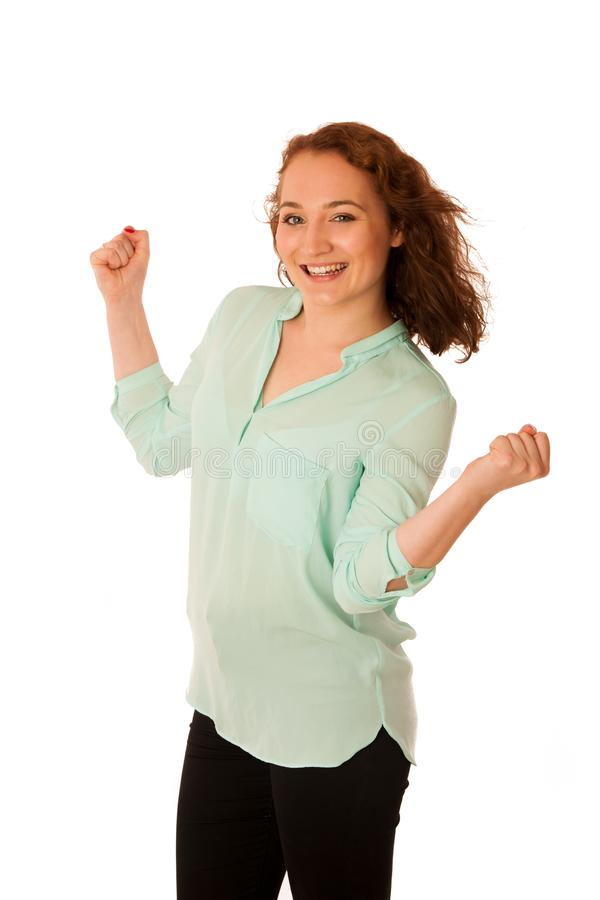 La donna di affari si tiene per mano nell'aria come gesto di grande succ immagine stock