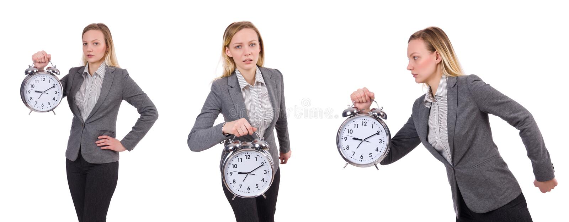 La donna di affari in sveglia grigia della tenuta del vestito isolata su bianco fotografia stock