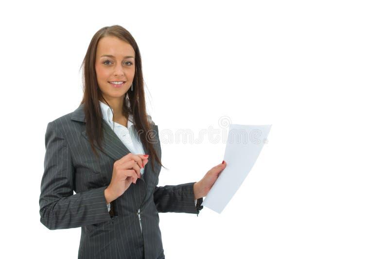 La donna di affari tiene lo strato immagini stock