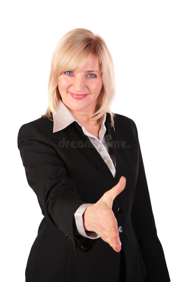 La donna di mezza età dà la mano fotografia stock