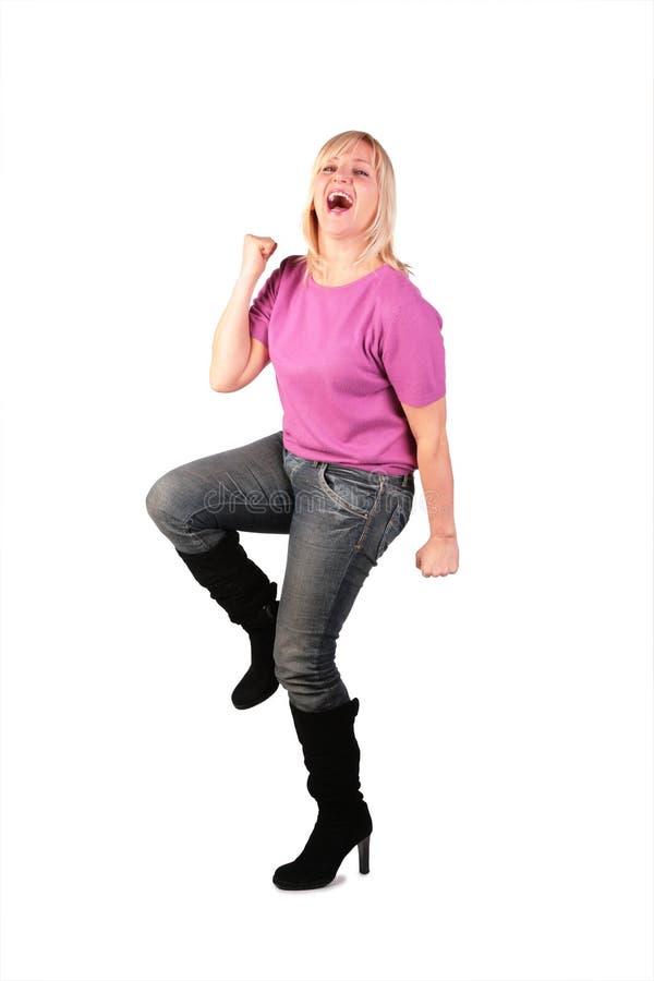 La donna di mezza età felice si leva in piedi il dancin immagine stock libera da diritti