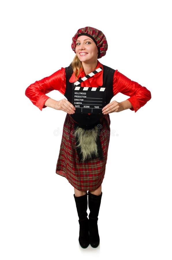 La donna divertente in abbigliamento scozzese con il film fotografia stock