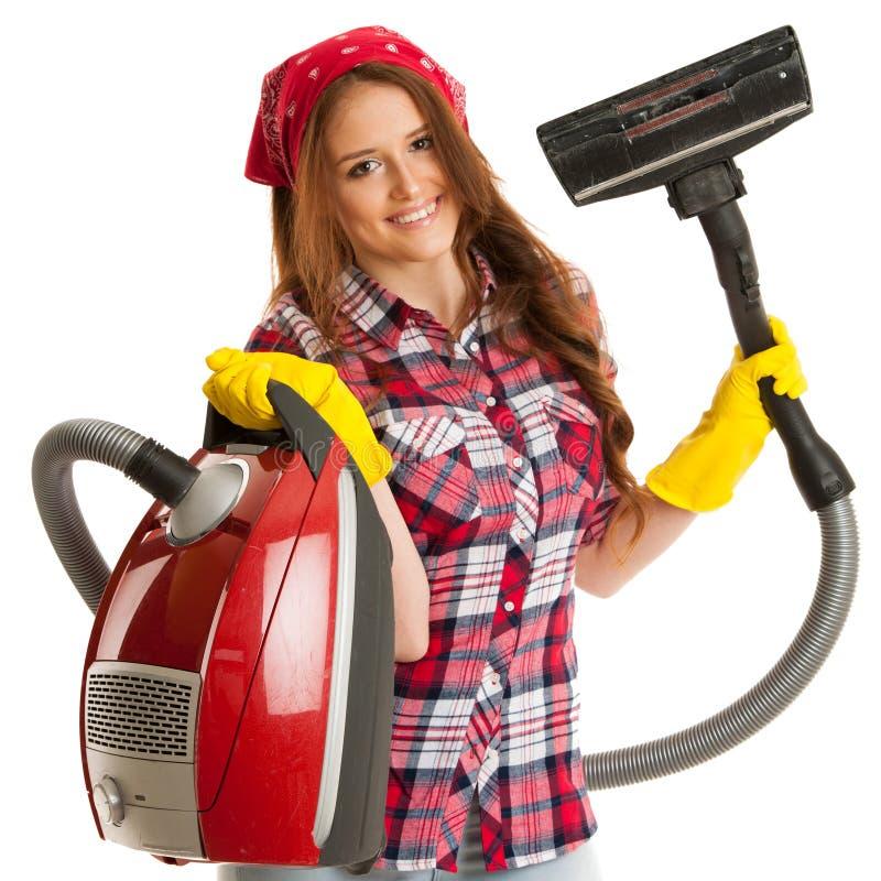 La donna felice pulisce con l'aspirapolvere isolato sopra backg bianco fotografia stock