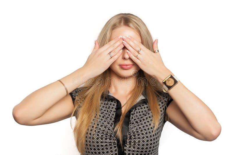 La donna graziosa dentro non vede gesto diabolico immagini stock libere da diritti
