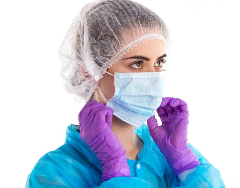 La donna indossa la maschera immagini stock