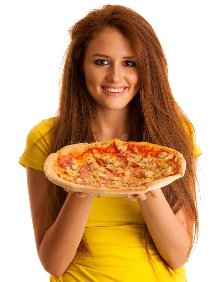 La donna mangia la pizza deliziosa isolata sopra fondo bianco fotografia stock libera da diritti