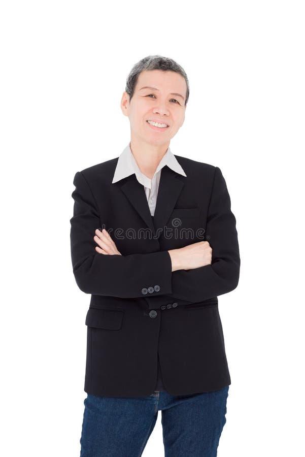 La donna senior sorride sopra fondo bianco immagini stock libere da diritti