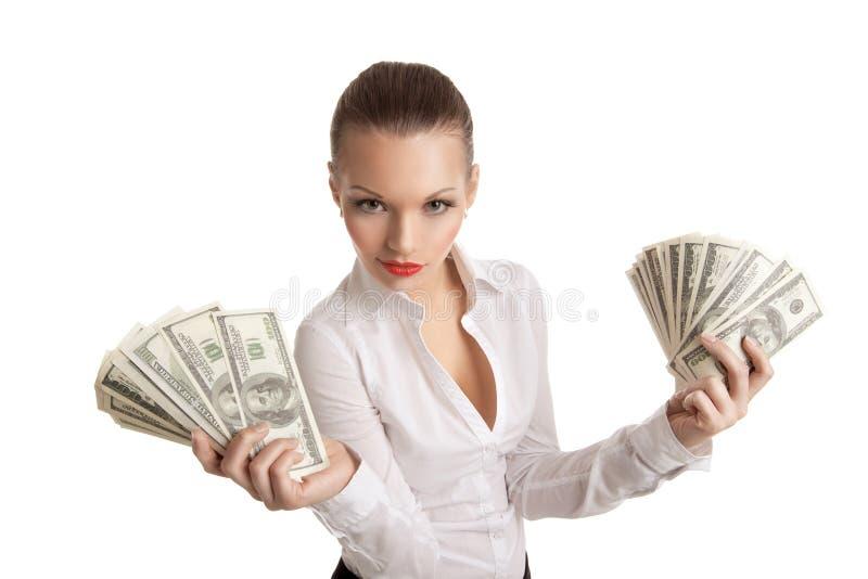 La donna sexy di affari cattura un gruppo di soldi fotografie stock