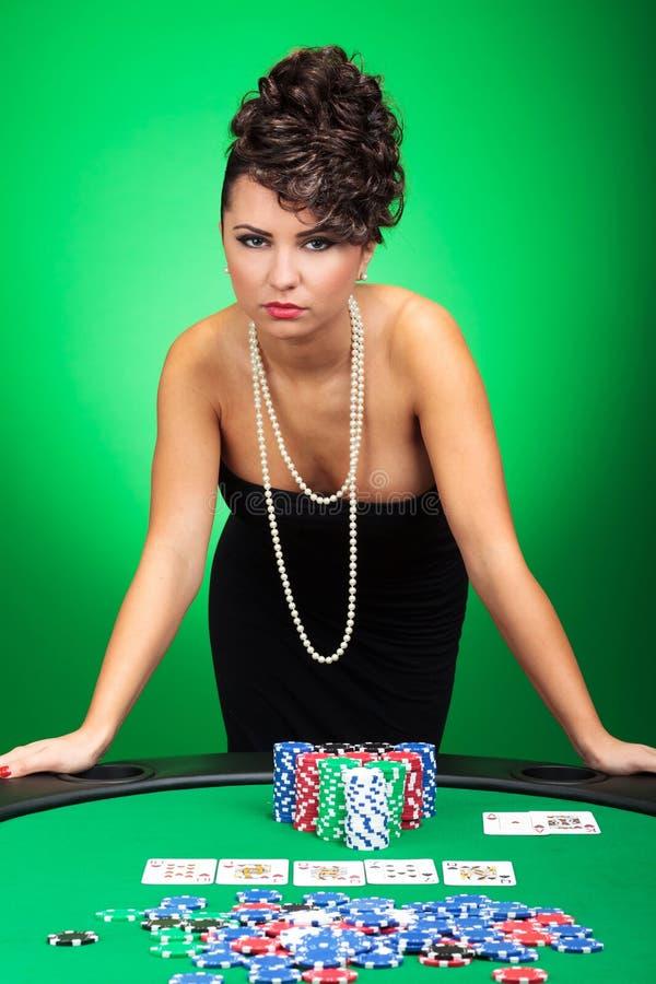 La donna sexy mostra la mano di mazza fotografie stock