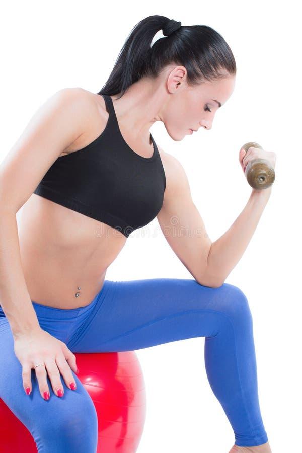 la donna sexy nel reggiseno di sport si esercita immagini stock