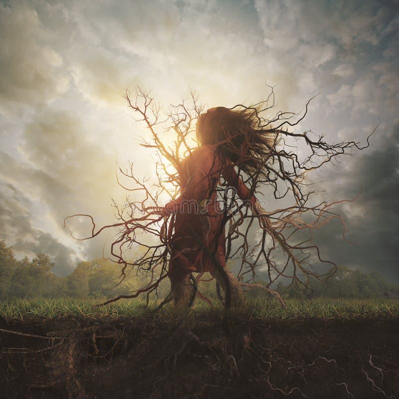 La donna si è piantata in terra immagine stock