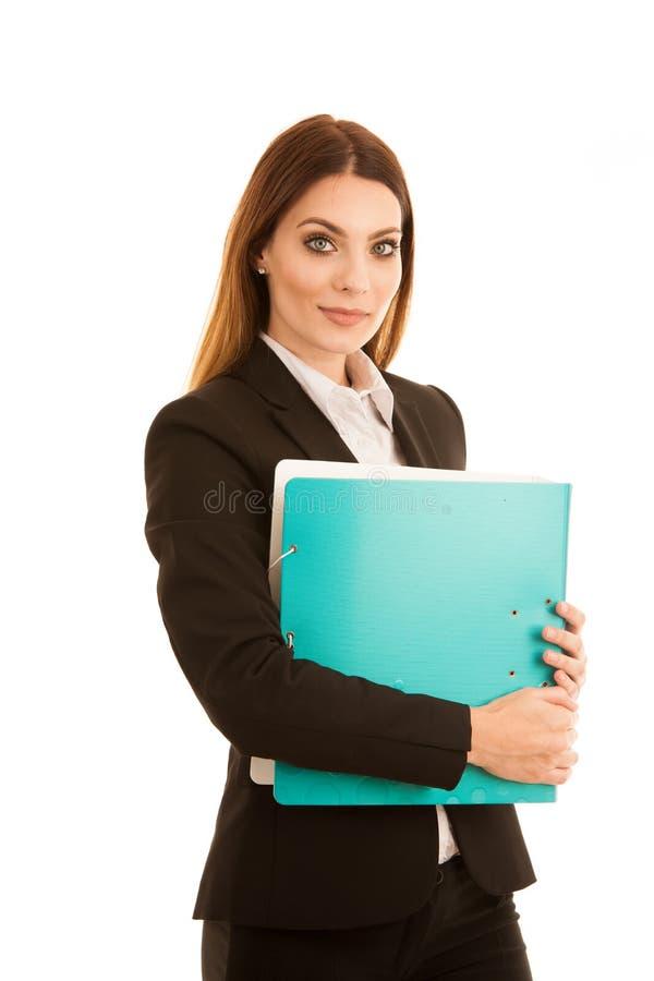 La donna sicura attraente di affari tiene un fascicolo di documenti fotografia stock