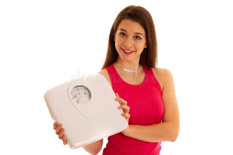 La donna sportiva tiene una foto concettuale di stile di vita sano della scala fotografie stock libere da diritti