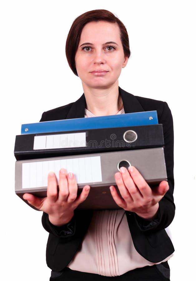 La donna tiene un mucchio delle cartelle immagini stock libere da diritti