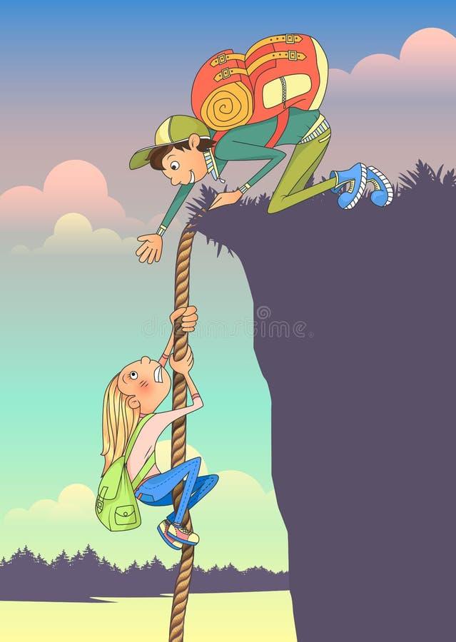 La donna turistica scala una roccia sulla corda e un uomo estende la sua mano e prova ad aiutare fotografia stock libera da diritti