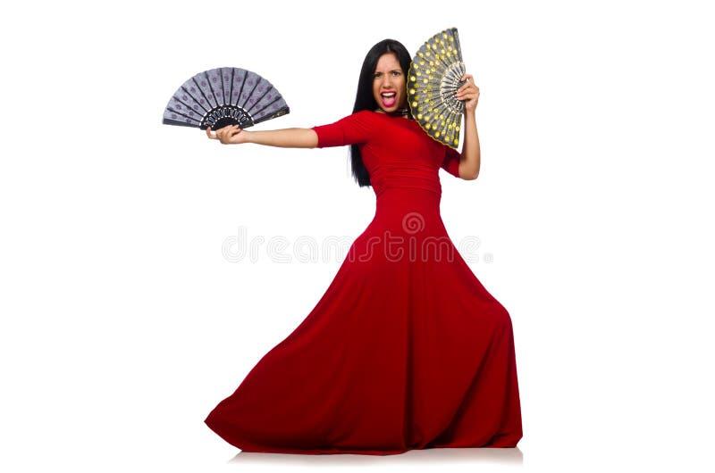 La donna in vestito rosso con il fan isolato su bianco immagine stock libera da diritti