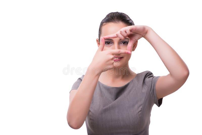 La empresaria joven que lleva a cabo las manos en forma del marco imagen de archivo libre de regalías