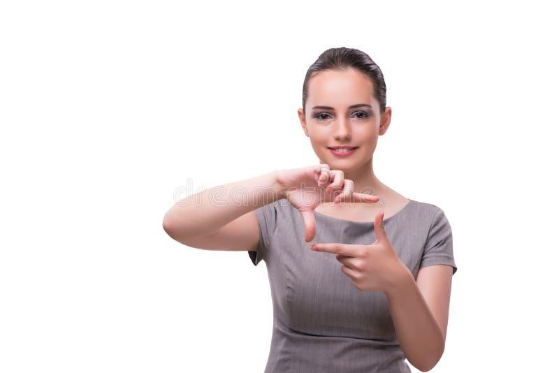 La empresaria joven que lleva a cabo las manos en forma del marco imagenes de archivo