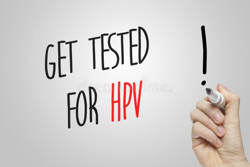 La escritura de la mano consigue probada para HPV fotografía de archivo