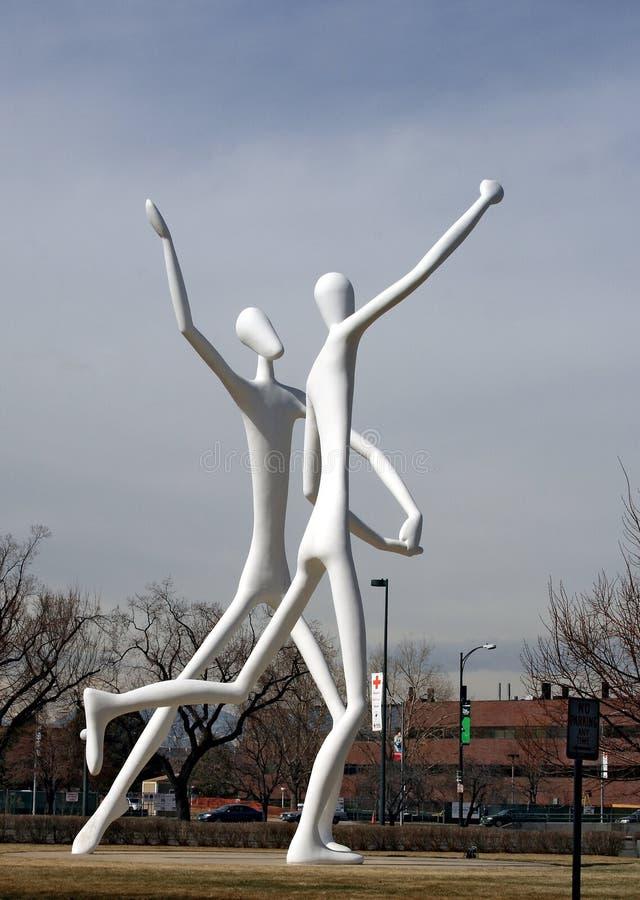 La escultura pública de los bailarines en Denver imagen de archivo