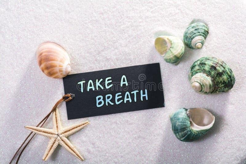 La etiqueta con toma una respiración imagen de archivo libre de regalías