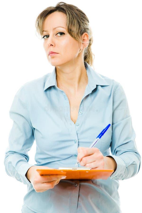 La fabricación de la mujer de negocios observa y se comporta estrictamente - el jefe riguroso en el trabajo imagen de archivo libre de regalías