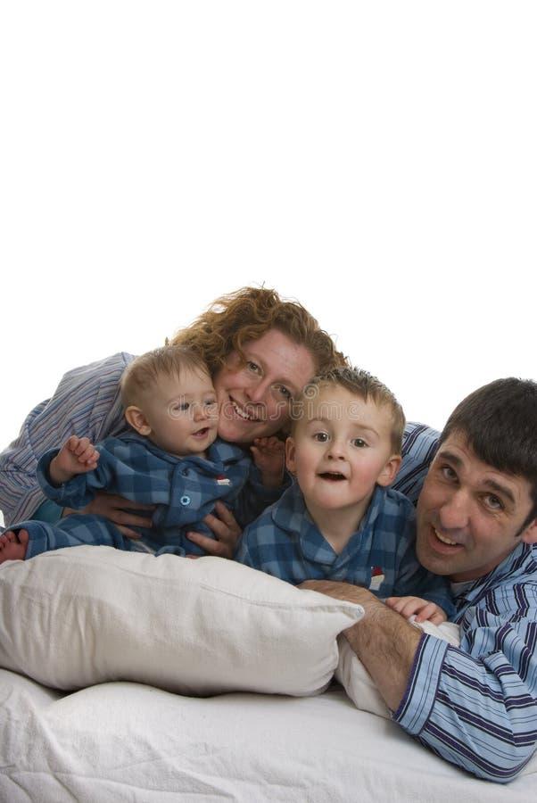 la famiglia quattro della base si distende fotografie stock