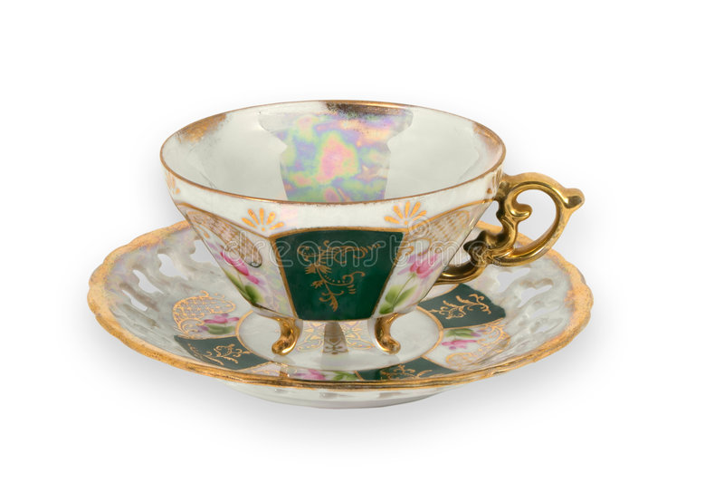 La fantaisie a doré la tasse de thé image stock