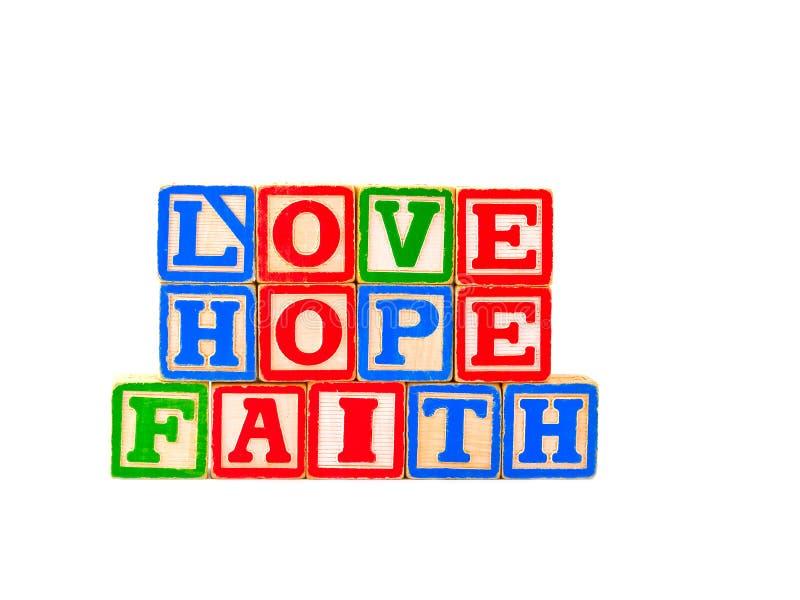 La fede, speranza, lettera di amore ostruisce 1 orizzontale fotografia stock libera da diritti