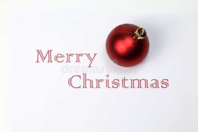 La Feliz Navidad con el espacio blanco del ornamento de la bola de la decoración desea fotografía de archivo