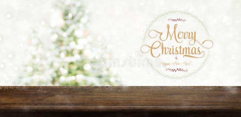 La Feliz Navidad y la Feliz Año Nuevo enrruellan con el te de oro del brillo imagenes de archivo