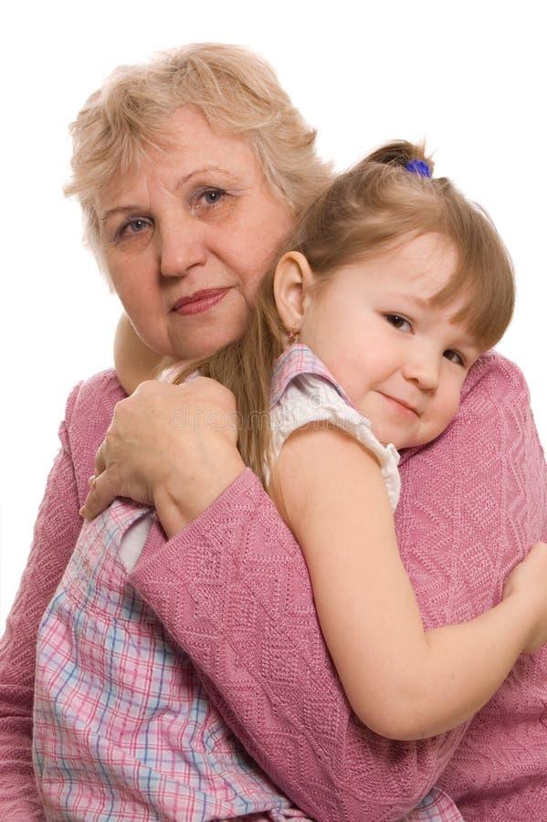 La femme âgée avec le descendant grand photo stock