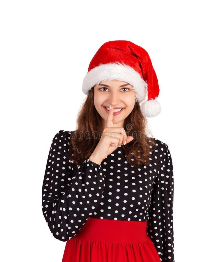 La femme agréable garde le doigt sur des lèvres, demande à ne pas dire l'information secrète ou à ne pas garder le silence fille  image stock