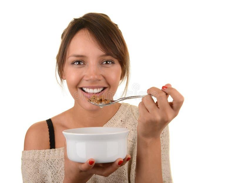 La femme apprécie sa céréale photos stock