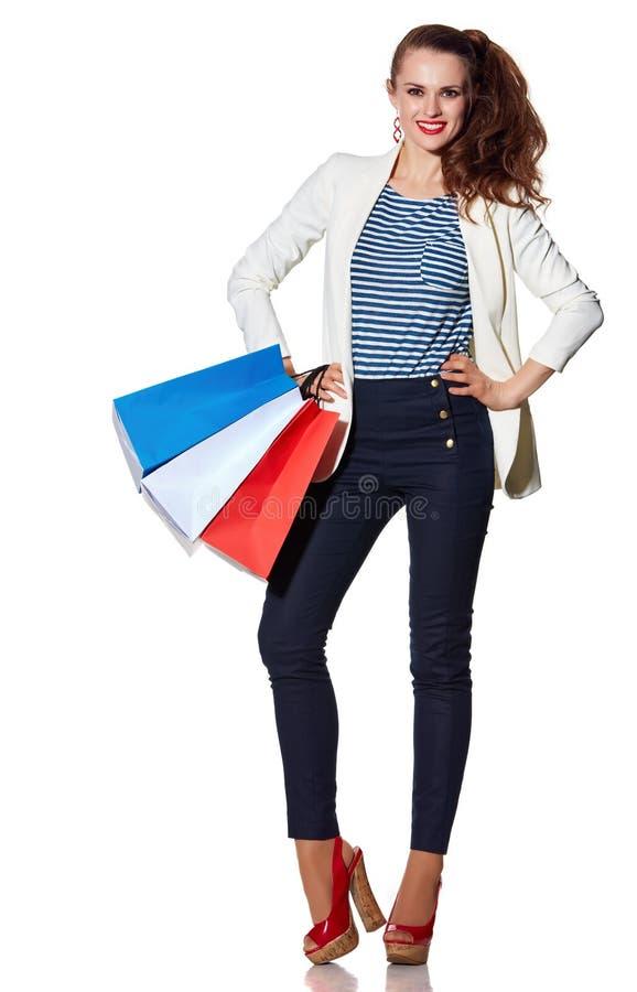 La femme avec le drapeau français colore des paniers sur le fond blanc images stock