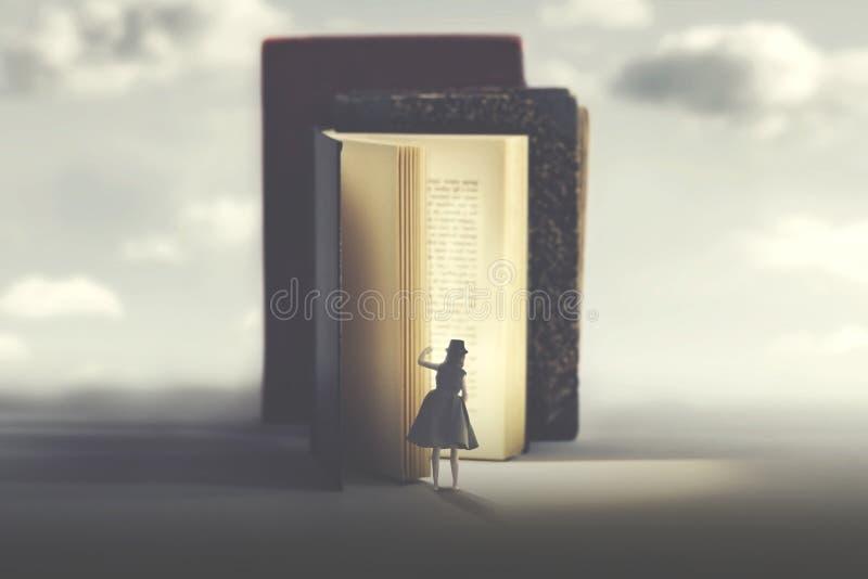 La femme curieuse regarde dans un livre lumineux mystérieux photos stock