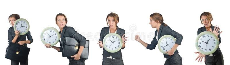 La femme d'affaires avec l'horloge d'isolement sur le blanc image stock