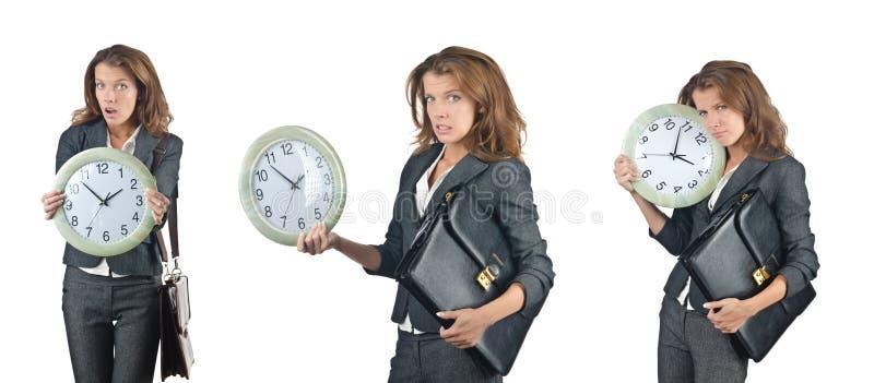 La femme d'affaires avec l'horloge d'isolement sur le blanc photo stock
