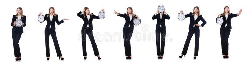 La femme d'affaires avec l'horloge d'isolement sur le blanc photographie stock