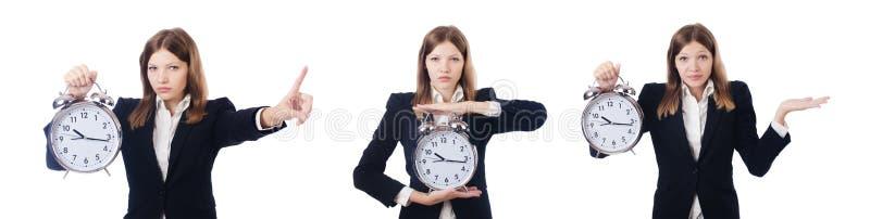 La femme d'affaires avec l'horloge d'isolement sur le blanc image libre de droits