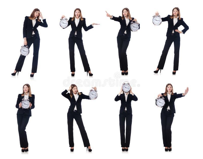 La femme d'affaires avec l'horloge d'isolement sur le blanc photos stock