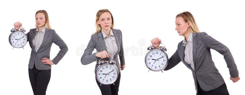 La femme d'affaires dans le costume gris jugeant le réveil d'isolement sur le blanc photo stock