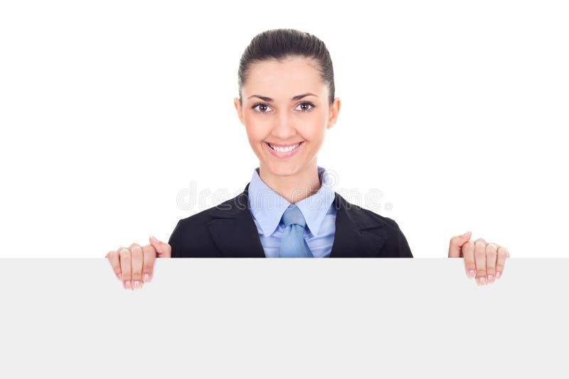 La femme d'affaires de sourire retenant le blanc chantent image stock